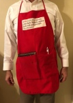 This image has an empty alt attribute; its file name is red-apron-2.jpg